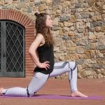 Female GymnasticBodies athlete demonstrates a hip flexor lunge stretch.