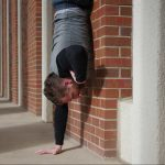 GymnasticBodies athlete shows off his handstand wall run strength.
