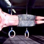 GymnasticBodies athlete uses a well-rounded core to hold a side lever.