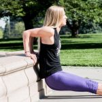 GymnasticBodies female athlete demonstrates beginning dip progression, the tricep dip.