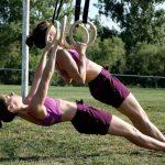 GymnasticBodies athlete perform ring rows.