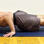 GymnasticBodies athlete demonstrates upper body and core control in a hollow back press.