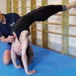 GymnasticBodies coach demonstrates proper bridge form.