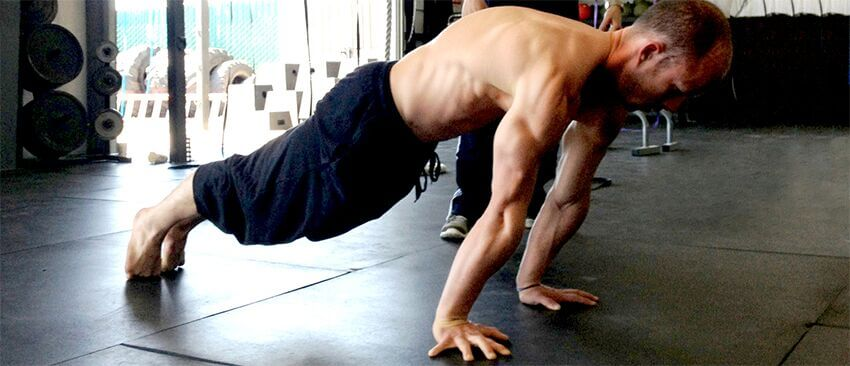 GB athlete trains a more advanced push-up progression from the GymnasticBodies Online Courses