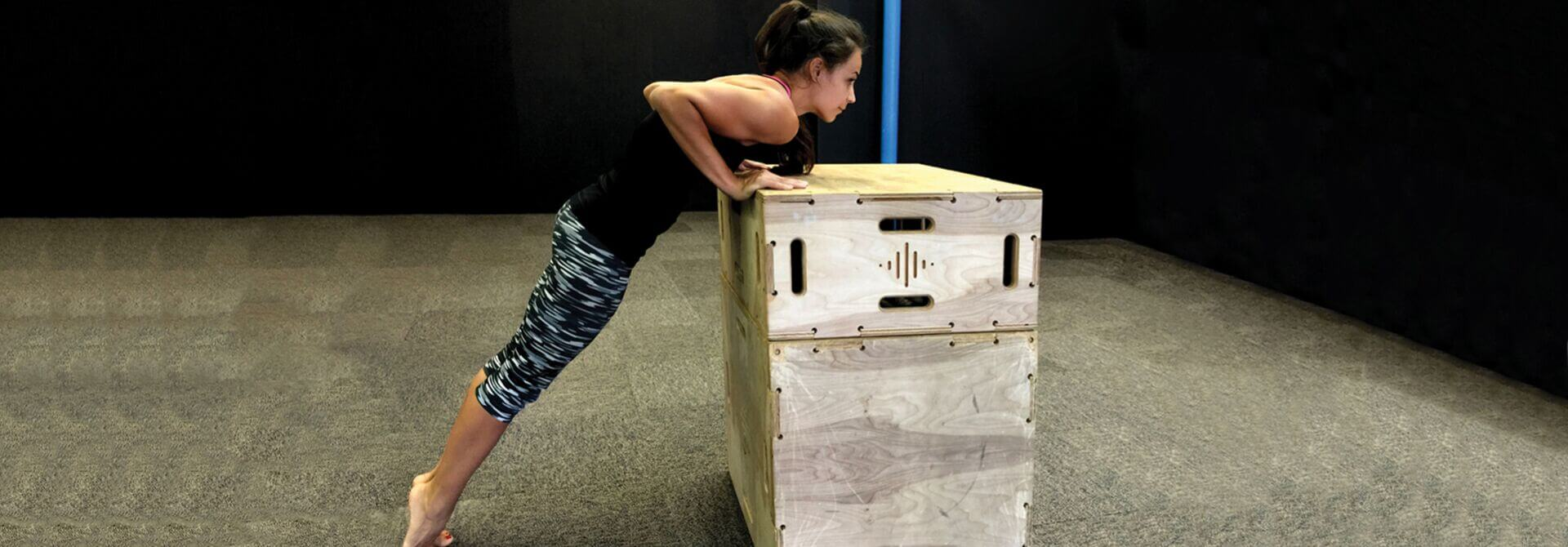 GymnasticBodies athlete demonstrates an incline pushup from the GB Foundation Series.