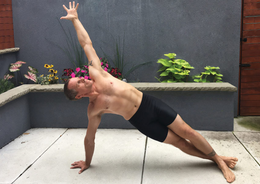 GymnasticBodies athlete demonstrates a side plank for core development.