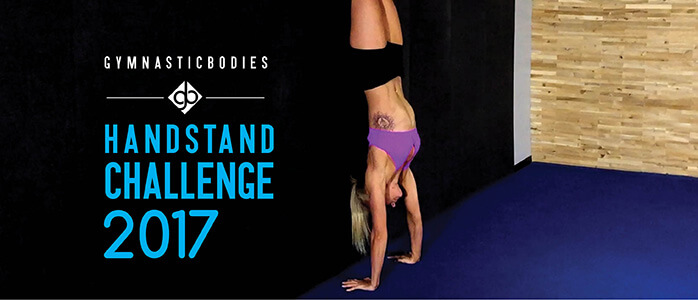 GymnasticBodies athlete demonstrates how to do a handstand with correct head position in day 4 of the handstand challenge.