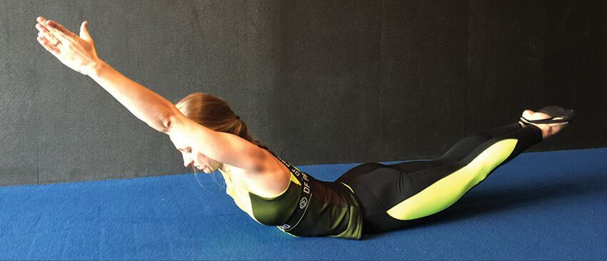 Christopher Sommer's female athlete demonstrates how to strengthen the core with an arch hold exercise.