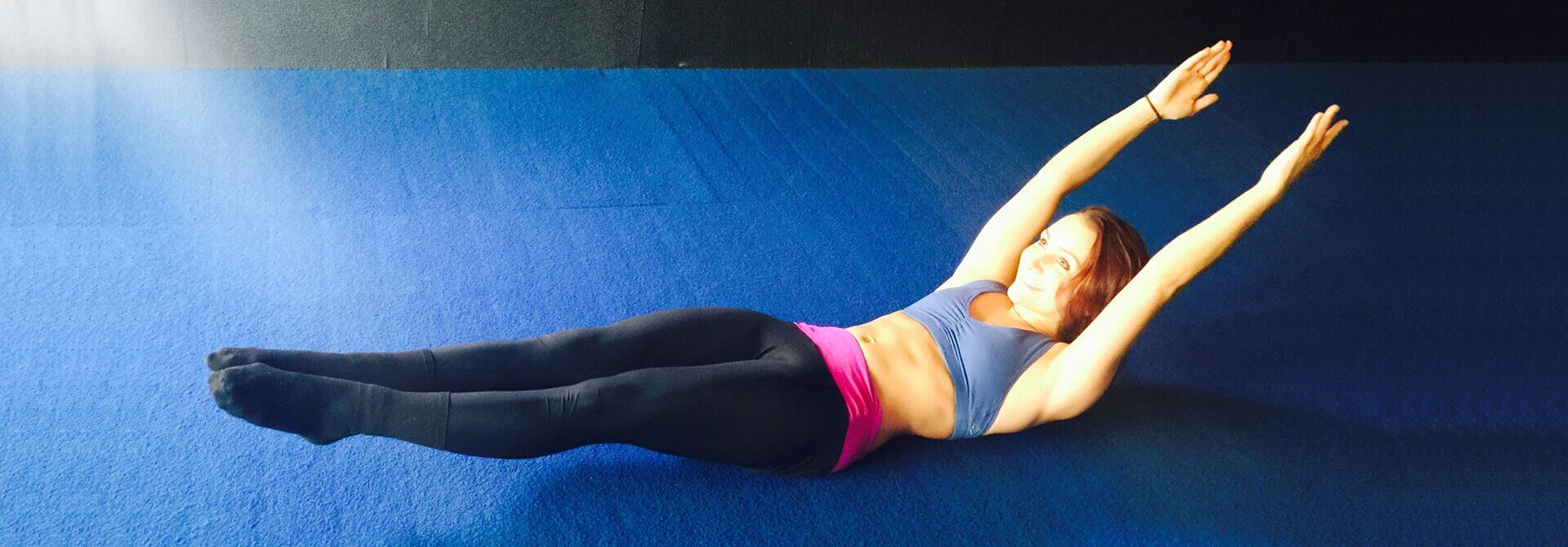 GymnasticBodies female athlete demonstrates how to build your 6-pack abs with the hollow body hold.