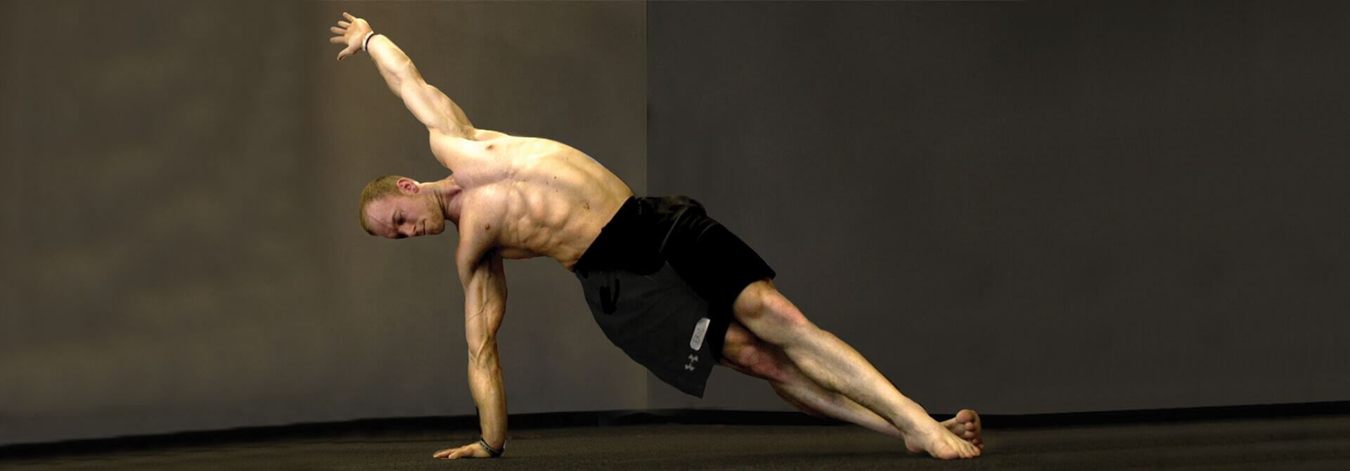GymnasticBodies athlete demonstrates how body weight and side planks can build obliques for a more stable core.
