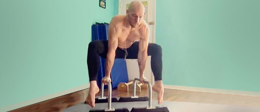 Christopher Sommer's athlete demonstrates upper body and cores strength in this straddle L progression.