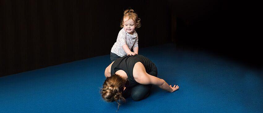Christopher Sommer's female athlete balances motherhood with her fitness regime.