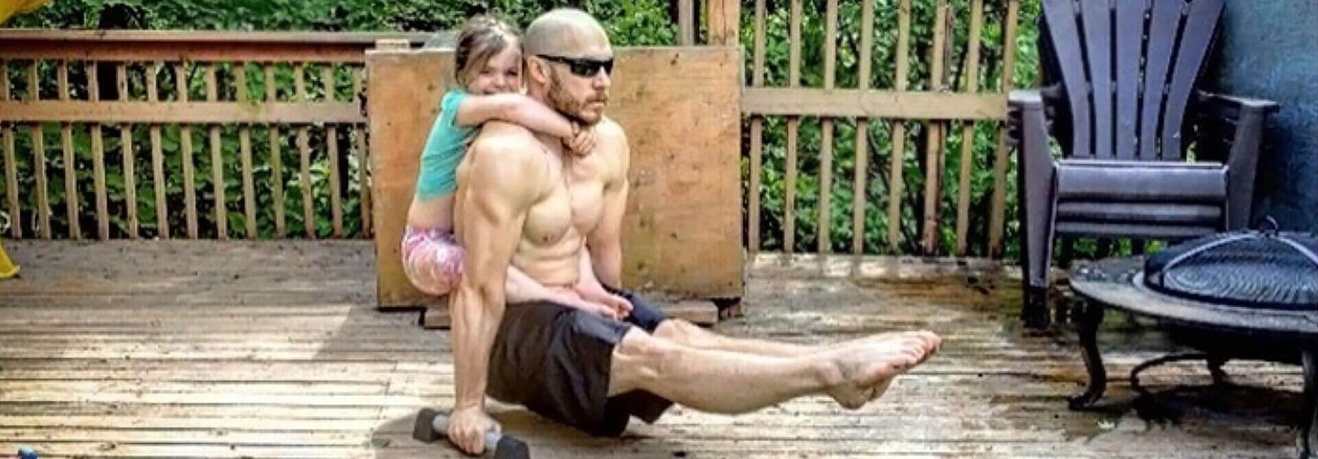 GymnasticBodies athlete demonstrates core control, with the added weight of his heroic fatherhood.