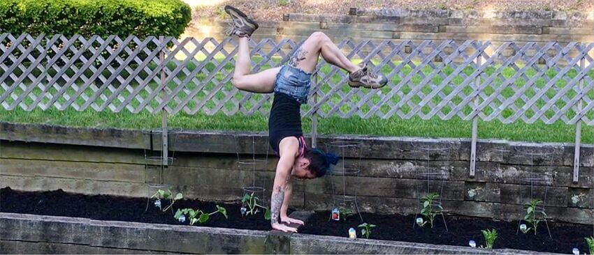 Christopher Sommer's athlete demonstrates a handstand while gardening.