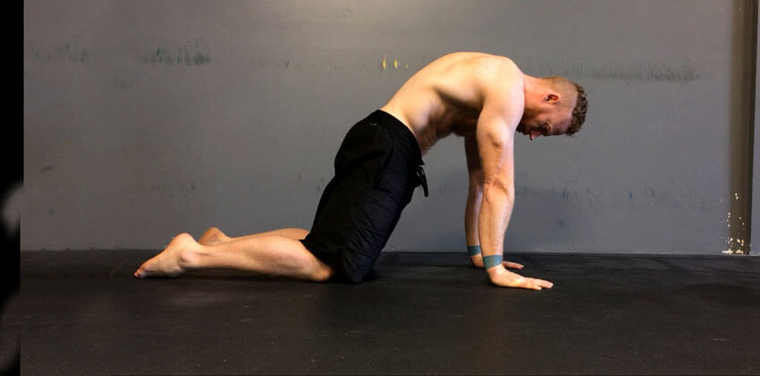 GymnasticBodies athlete demonstrates the flexibility and shoulder movement that maximizes your bench press.