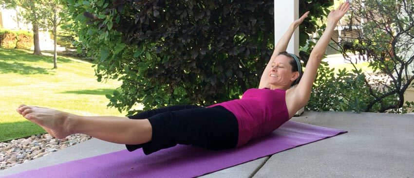 Christopher Sommer's female athlete finds time to work on her abs with a hollow body hold.
