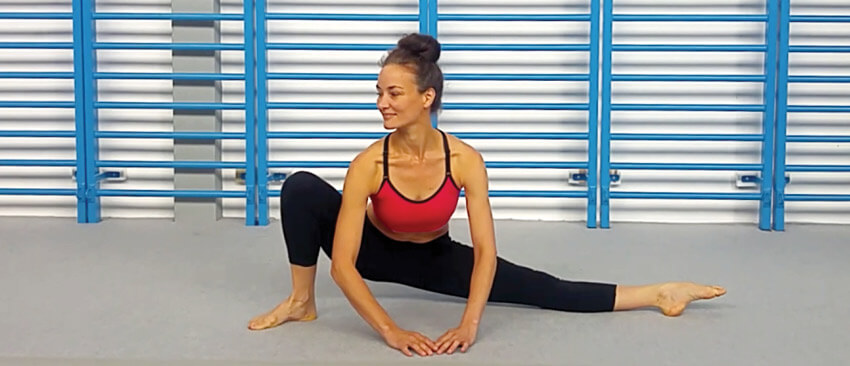 Christopher Sommer's female athlete demonstrates an adductor stretch, the standing frog.