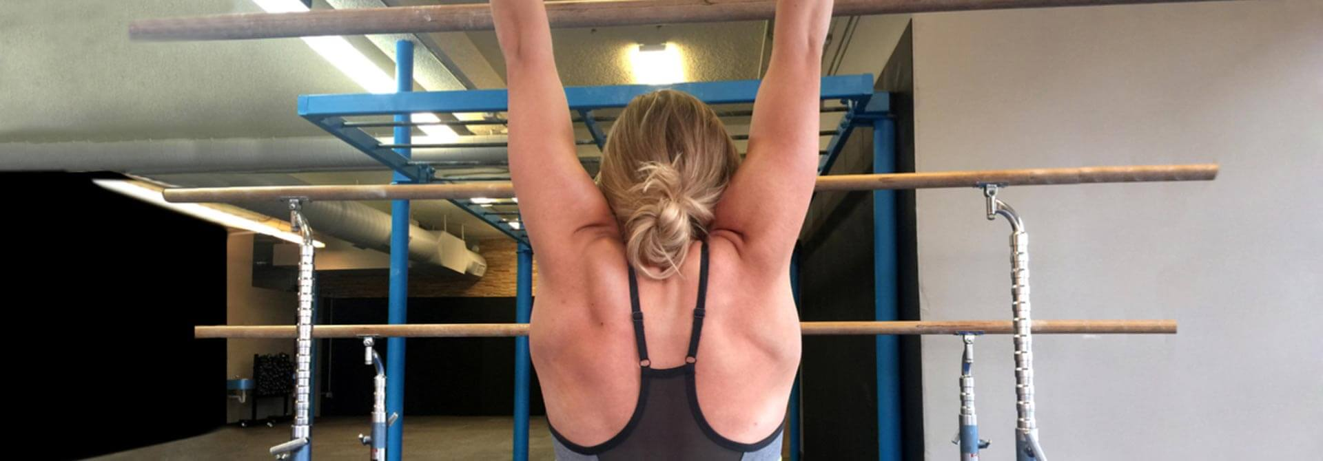 GymnasticBodies female athlete demonstrates a basic shoulder strengthening exercise.