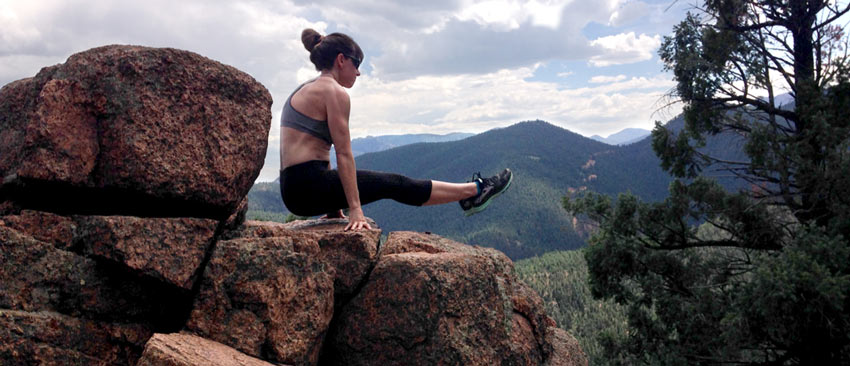 Christopher Sommer's female athlete adds a core and lat workout to her hike by doing L-sits.