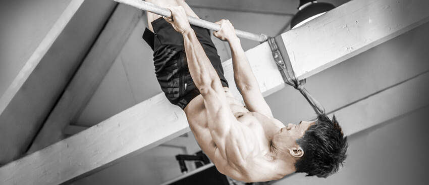 GymnasticBodies athlete performs an incredible feat of hanging strength on a single bar.