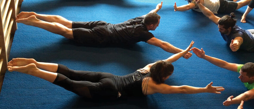 GymnasticBodies athletes train their core in a group atmosphere to stay motivated and strong together!