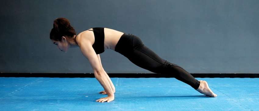 Christopher Sommer's female athlete demonstrates wrist stability, forearm strength, and lat stability with a planche lean.