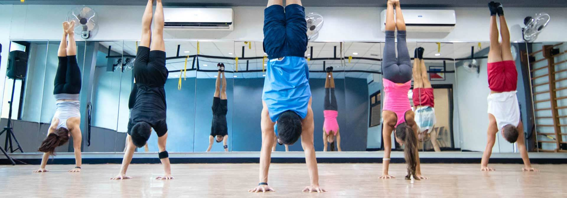GymnasticBodies athletes show off their handstand control.