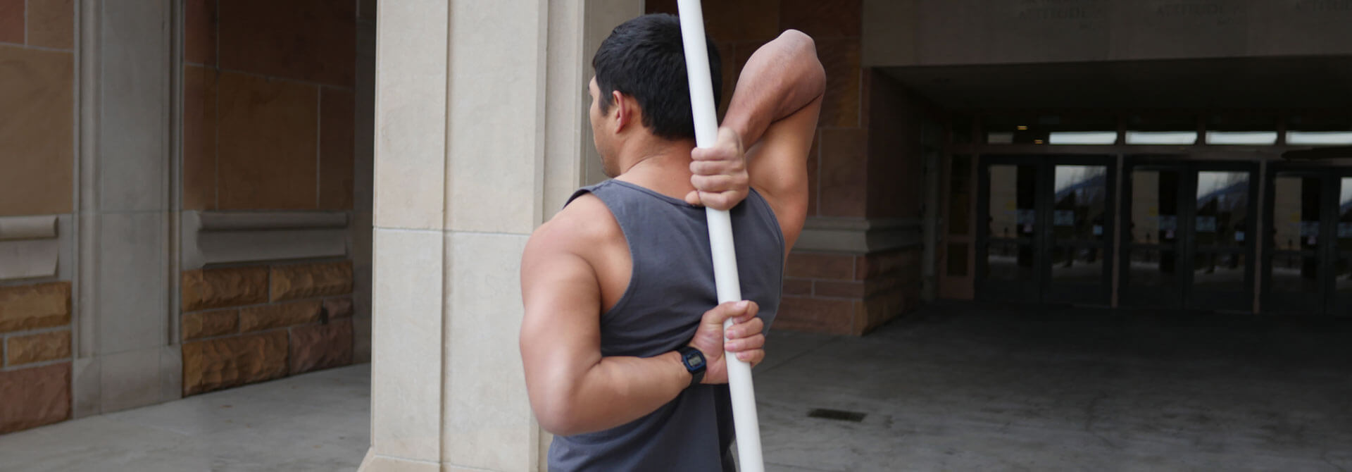GymnasticBodies Athlete performs a shoulder mobility exercise for improved quality of life.