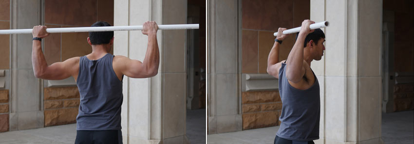 Strong GymnasticBodies athlete performs a static lat fly for shoulder mobility.