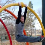 GymnasticBodies athlete demonstrated grip strength, core control, and upper body mobility with an undergrip dead hang.